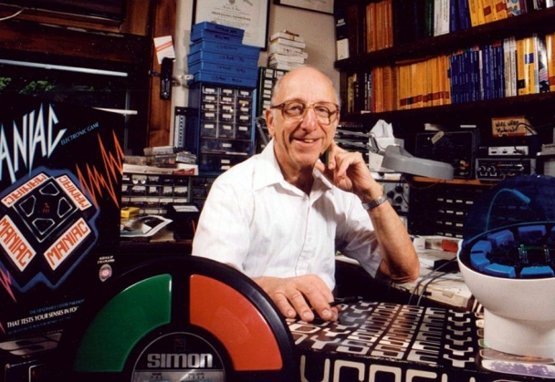 Baer with several of his key inventions, the Odyssey game console and Simon electronic toy. (Image by Ralph Baer)